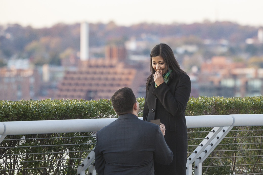 Mahesh Raju proposes to Seema Patil on the rooftop terrace of the Kennedy Center for Performing Arts in Washington, DC, November 15, 2014. All images are protected under international and domestic copyright laws. For more information about the images and copyright information, please contact info@momentacreative.com. Photos by http://www.MomentaCreative.com.