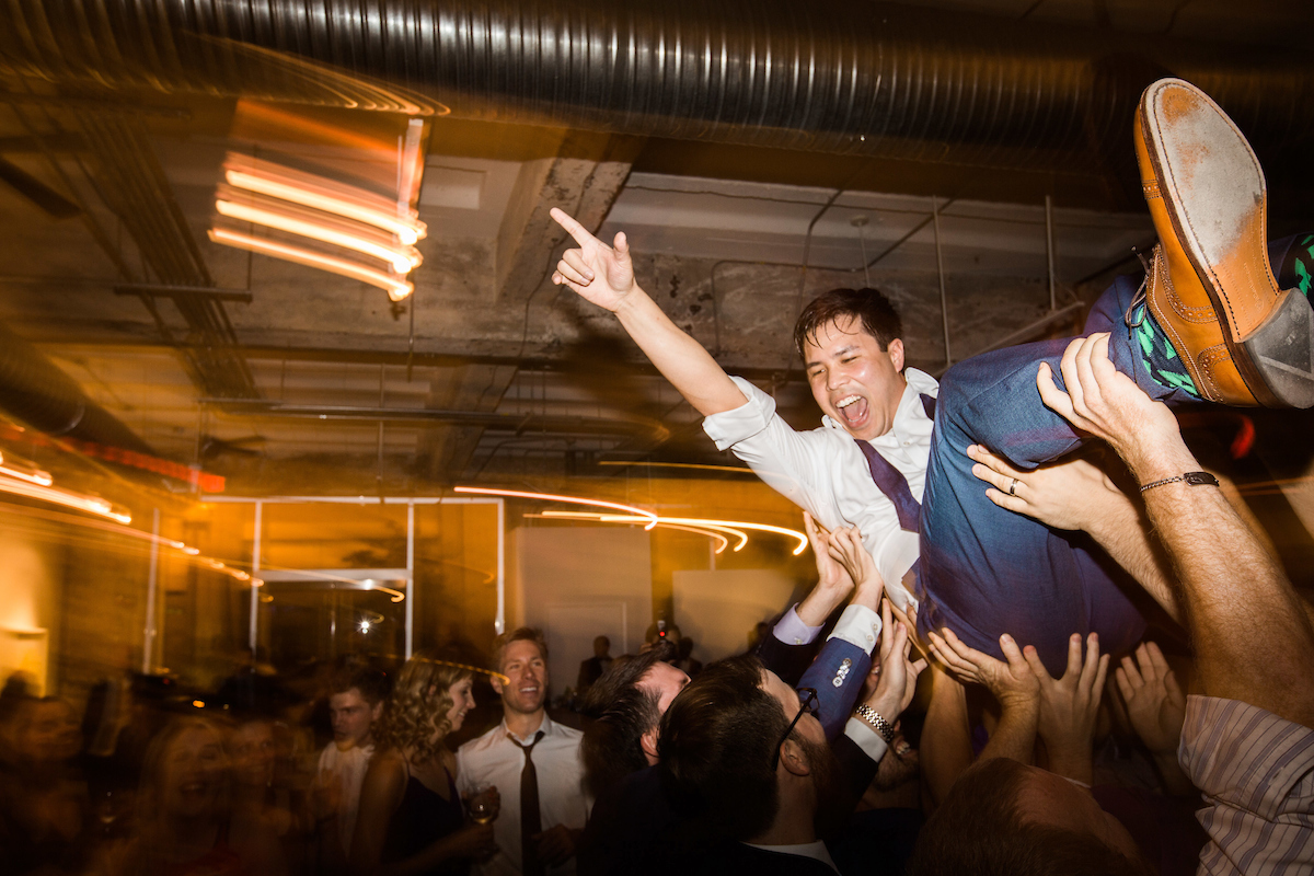 party reception energetic crowdsurfing fun