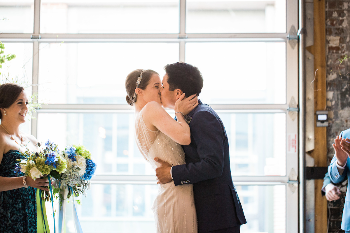 art gallery ceremony kiss
