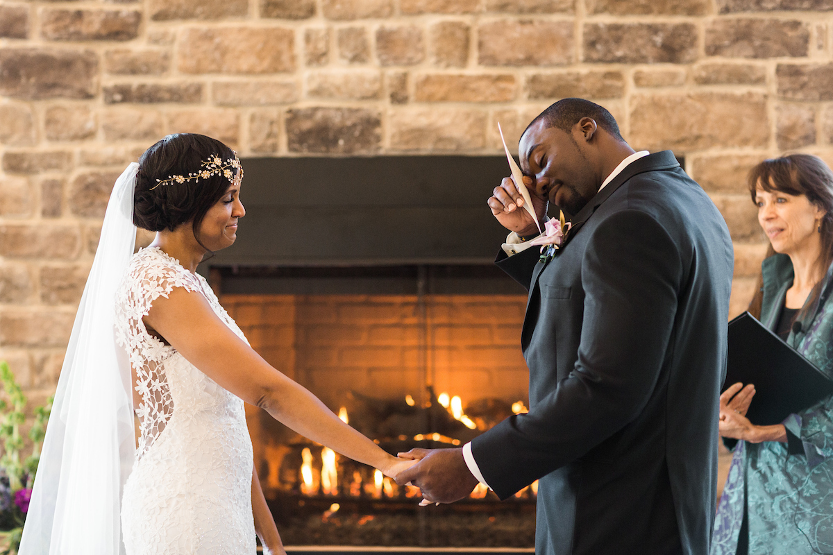 emotional groom fireplace ceremony