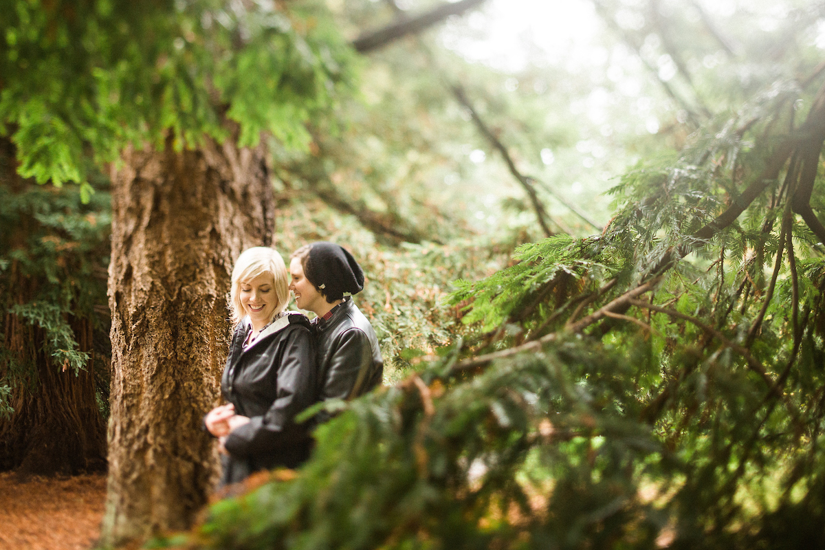 same sex lesbian couple seattle forest pine trees tilt shift