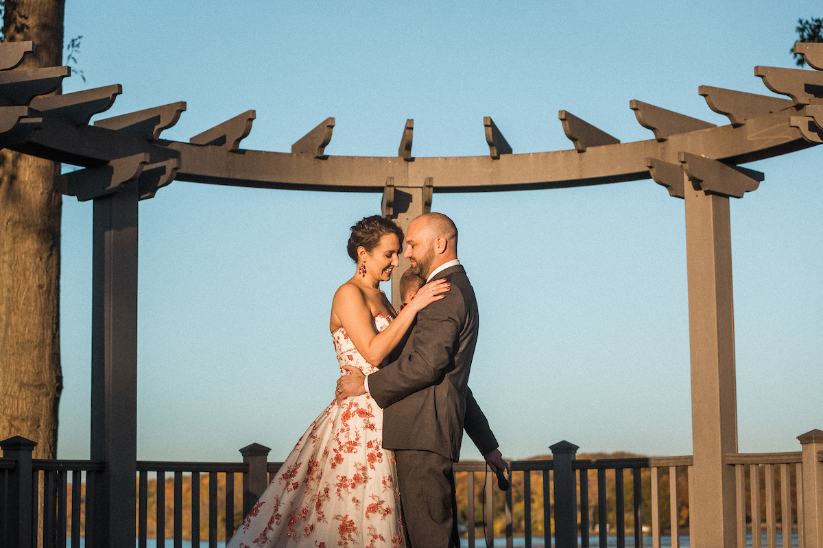 outdoor sunset wedding embrace romantic