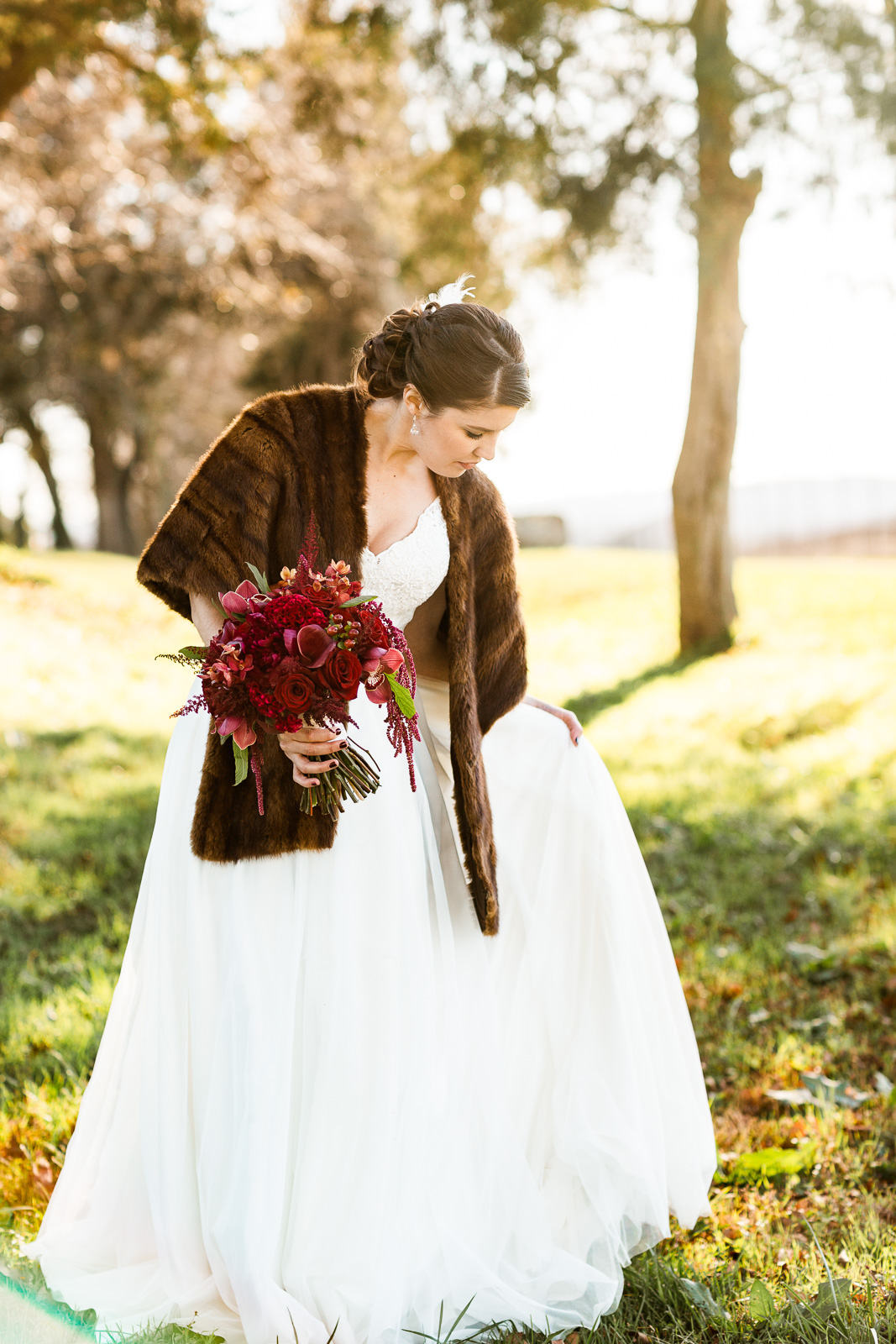 bride portrait fur coat red wedding bouquet bride
