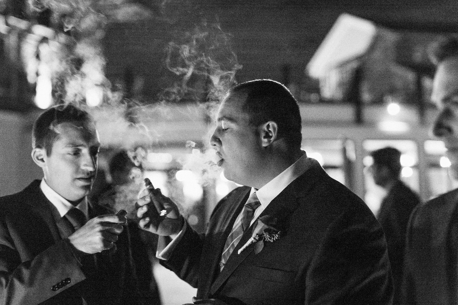 cigar smoking at night wedding reception