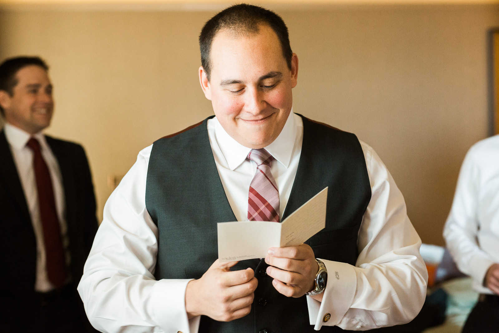 emotional groom reading bride's letter
