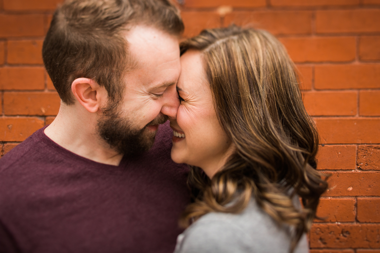 giggling romantic engagement photos