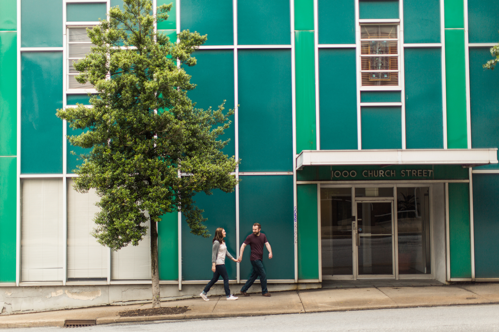 funky teal building engagement photos