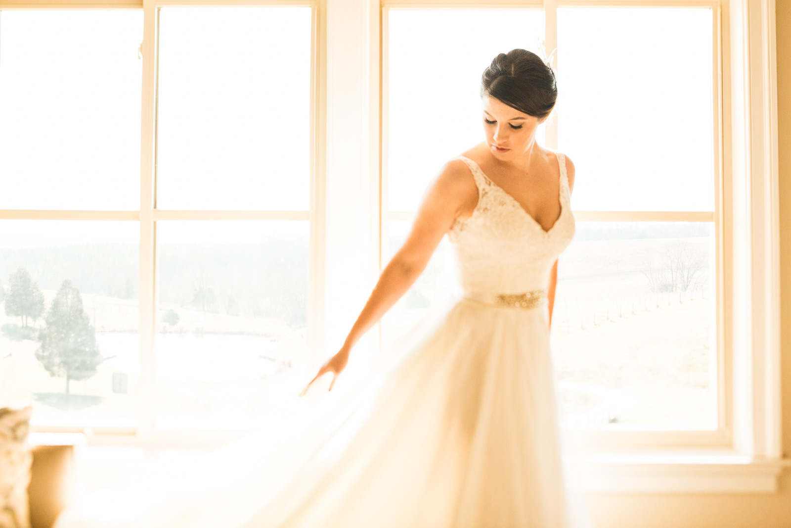 beautiful golden light getting ready bridal portrait