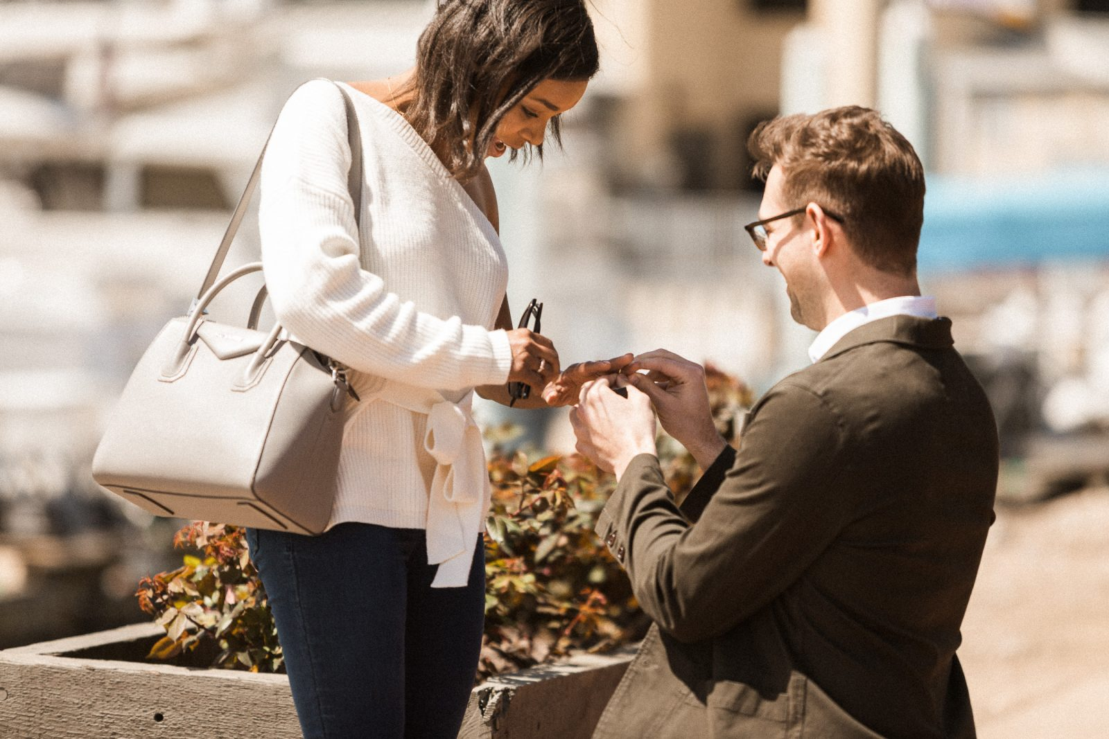 young man proposes to young woman in Canton, Baltimore near Fells Point in front of the restaurant where they had their first date