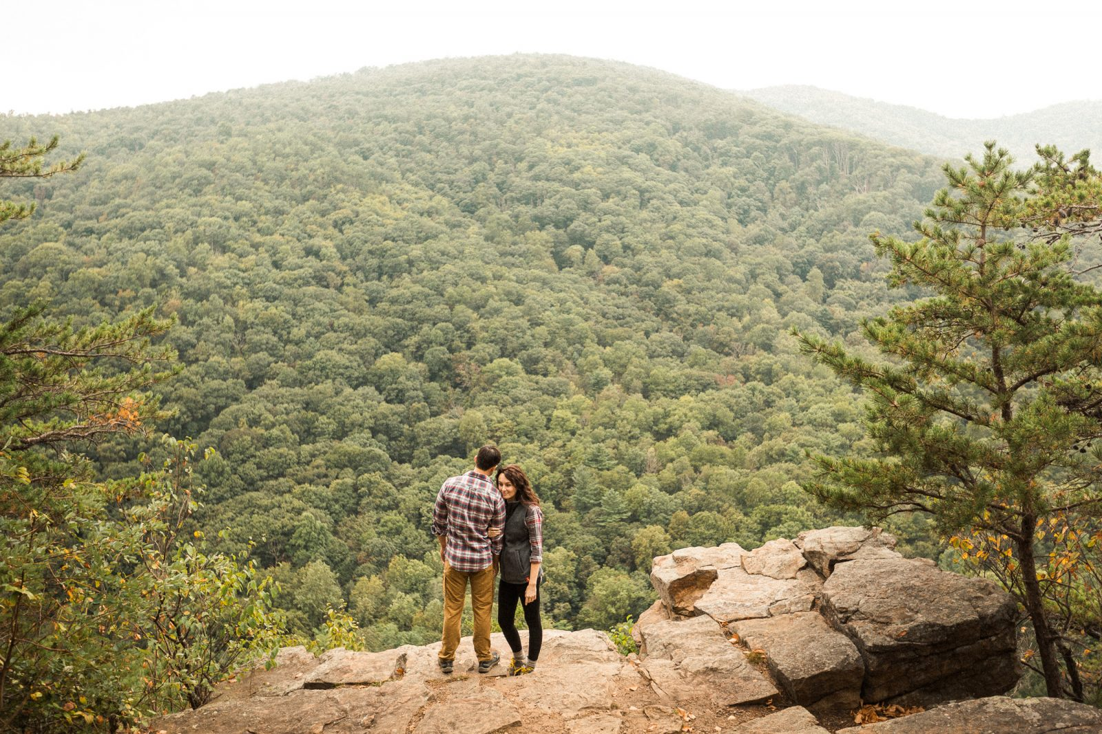 young couple hike to top of mountain to Cliff Trail Overlook at the George Washington National Forest in virginia